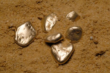 Six smooth pebble-sized gold nuggets
