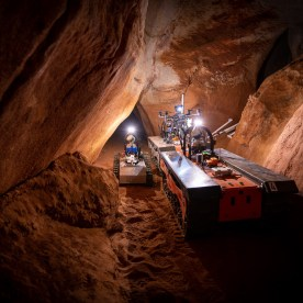Robots lined up inside the cave