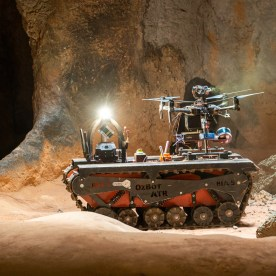 Drone about to be launched from tracked robot