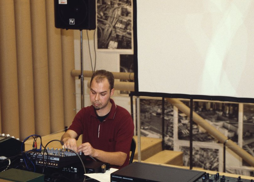 Mika Vainio performs at the opening of 'Cities on the Move 7', Museum of Contemporary Art Kiasma, Helsinki, 1999 Photo: Finnish National Gallery / Pirje Mykkänen