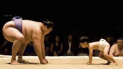 Large Sumo Wrestler vs. Child Sumo Wrestler