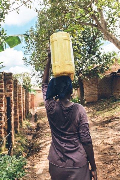 women carry water africa