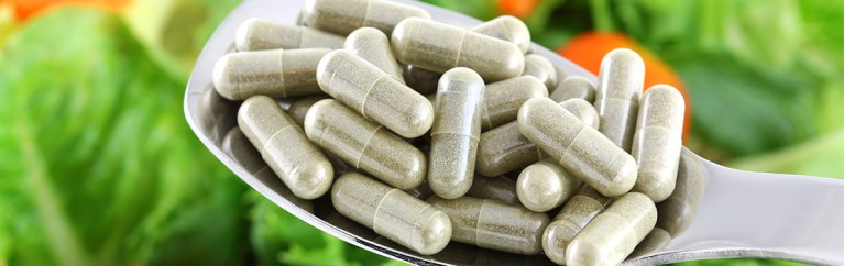 Spoon of pills or dietary supplements