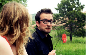 Man holding flower with woman in park