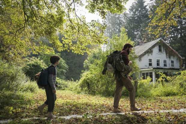 Left to right: Noah Jupe plays Marcus Abbott and John Krasinski plays Lee Abbott in A QUIET PLACE, from Paramount Pictures - A Quiet Place Review