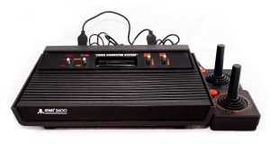 An Atari 2600 and two joysticks on a white background