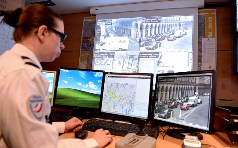 A French police officer watching for road traffic infringements in Paris