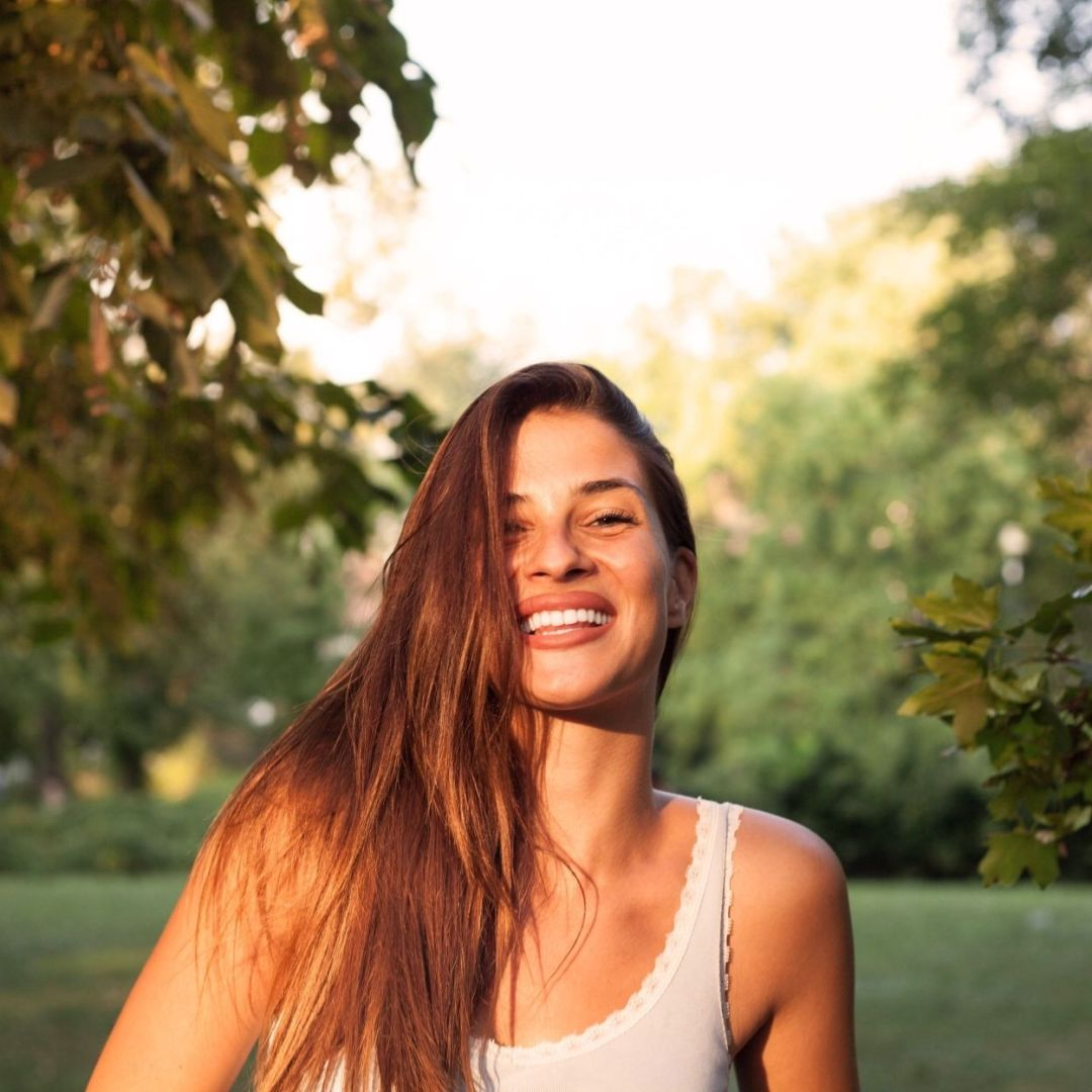 Happy Woman After Therapy for Trauma in Asheville, NC | Resilient Mind Counseling