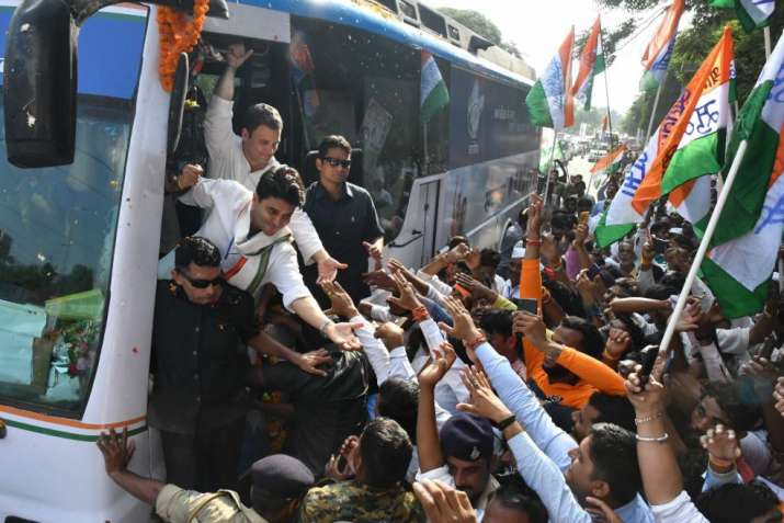 India Tv - Bhopal: Congress President Rahul Gandhi and celebration personality Jyotiraditya Scindia accommodate a supporters during a roadshow