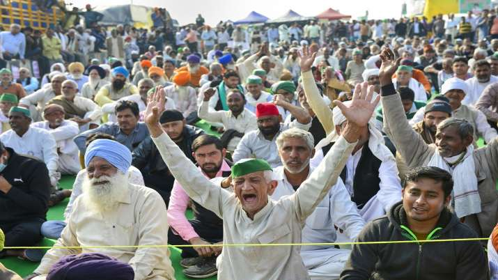 Farmers raise slogans during the ongoing protest against