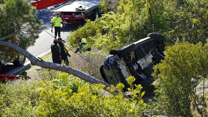 Indian Television - The vehicle is lying on its side after a rollover accident involving golfer Tiger Woods on Tuesday, February 23, 2021, in the suburb of Rancho Palos Verdes in Los Angeles.  Woods suffered leg injuries in the crash of a car and underwent surgery, authorities and his manager said.