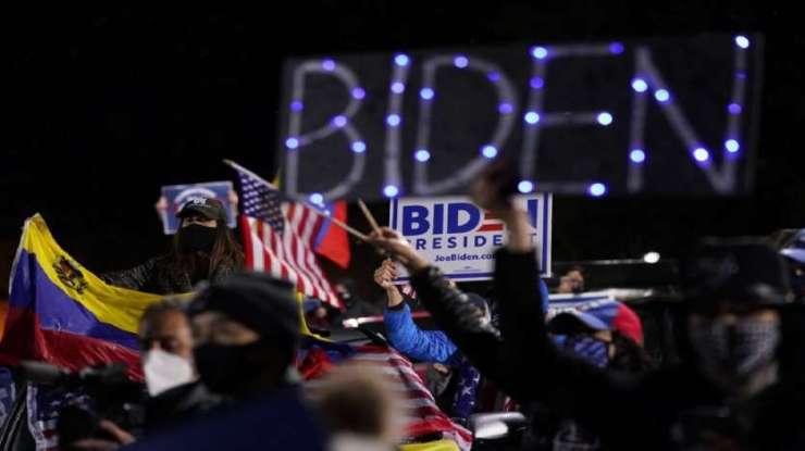Biden supporters listen as Democratic presidential candidate former Vice President Joe Biden speaks at a rally at Franklin Delano Roosevelt Park in Philadelphia.