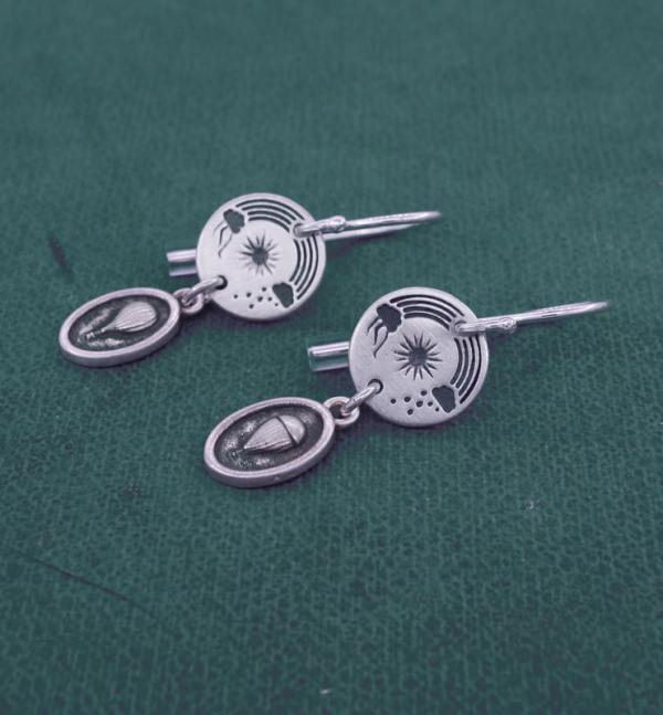 Small earrings d'round earrings with aerial sky patterns and 925 silver mini aerostat charms made in France side view | Res Mirum