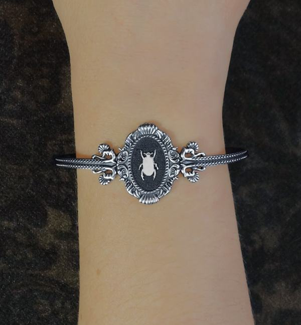Beetle and baroque mouldings bracelet inspired by d&#039 museums;natural history made in France worn | Res Mirum