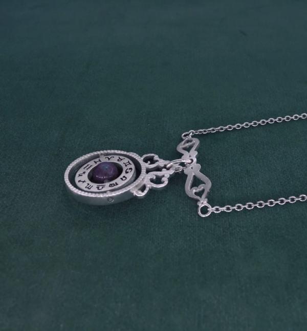 Collier sphère armillaire et arabesques avec axe tournant autour d'une perle de labradorite en argent massif made in France vue côté | Res Mirum
