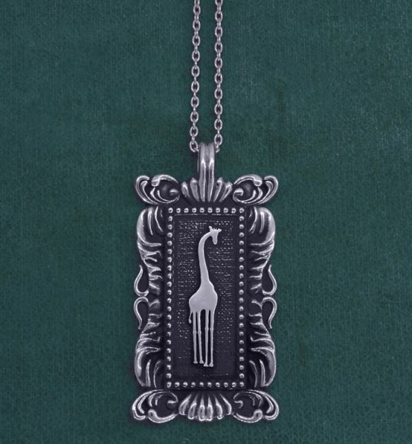 Rectangular pendant with giraffe motif & baroque frame imagined in l'museum spirit d'natural history silver | Res Mirum