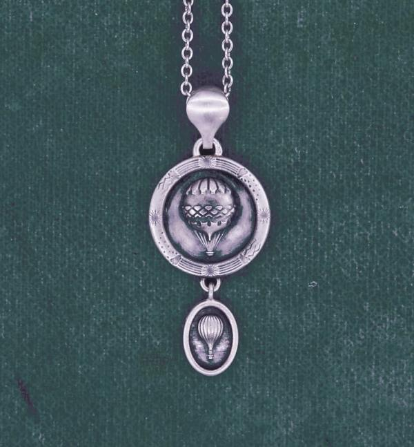 18th century handcrafted sterling silver mini balloon pendant in round frame inspired by the sky | Res Mirum