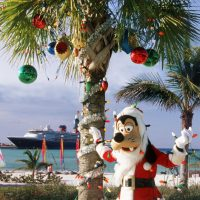 """The holidays take on a tropical flair at Disney's private island in the Bahamas, Castaway Cay, with """"snow flurries,"""" a decked-out Christmas tree, Disney character meet-and-greets and holiday island music. (Disney)"""