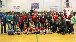 Interval International employees volunteer at the company's 23rd Annual Holiday Toy Fest at the Gibson Bethel Community Center in South Miami. More than 250 children from the community received gifts and participated in holiday festivities.