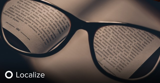 Best Practice for Measuring Transcreation Quality: Vview of a book looking through a pair of close reading glasses.