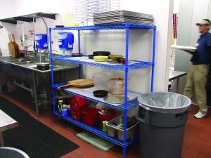 epoxy restaurant shelving in crowded kitchen