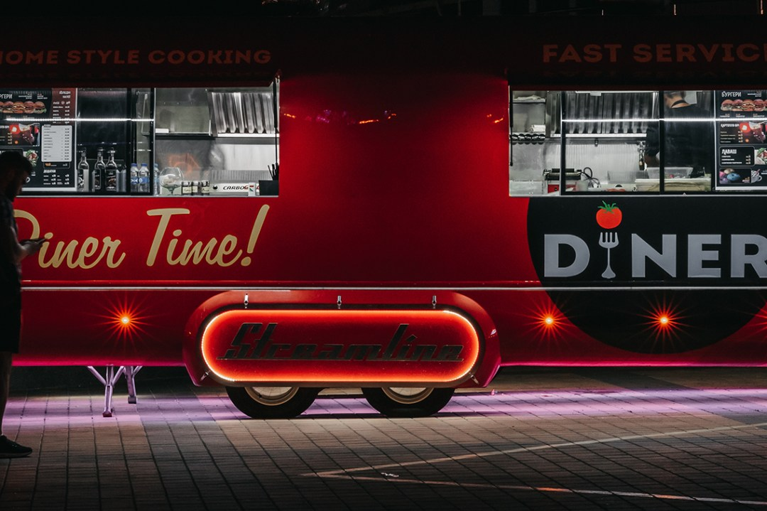 Lit up food truck at night