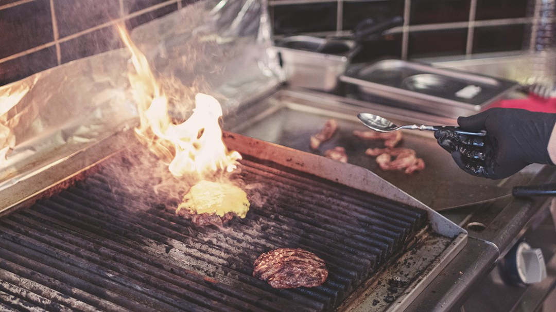 Grill cooking burgers