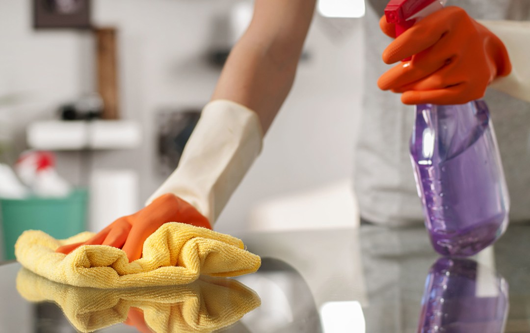 Disinfecting a stainless steel work surface for successfully killing viruses and bacteria using isopropyl alcohol.