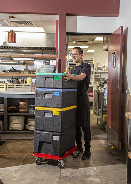 Cambro GoBox EPP Food Pan Carriers are easy to maneuver around establishments on a CamDolly