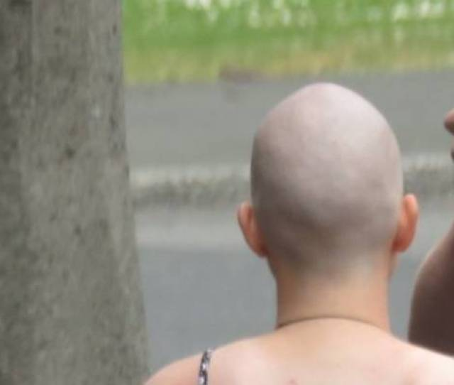 A Backpacker Is Filmed After Having Her Hair Shaved In Dunedin