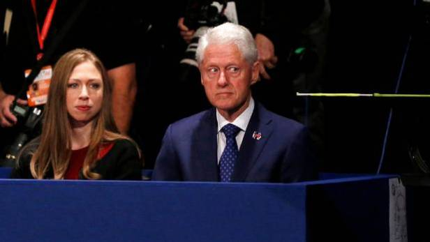 Hillary Clinton's husband, former President Bill Clinton, with daughter Chelsea at the debate.
