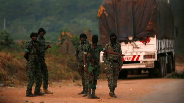 Mutinous soldiers who have taken control of Bouake, Ivory Coast stand at a checkpoint in the city.