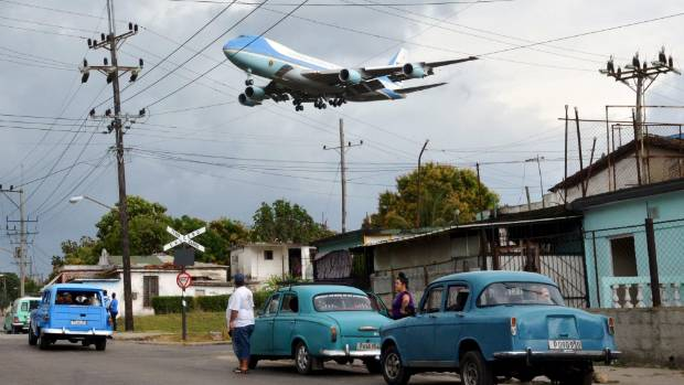 Boeing 747 Air Force One carries former US President Barack Obama and his family over a neighbourhood of Havana, Cuba.