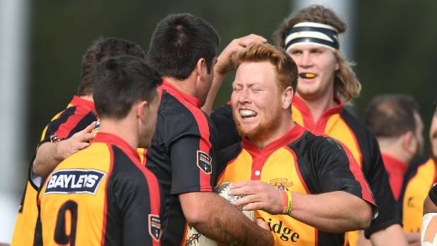 Thames Valley players celebrate a try.