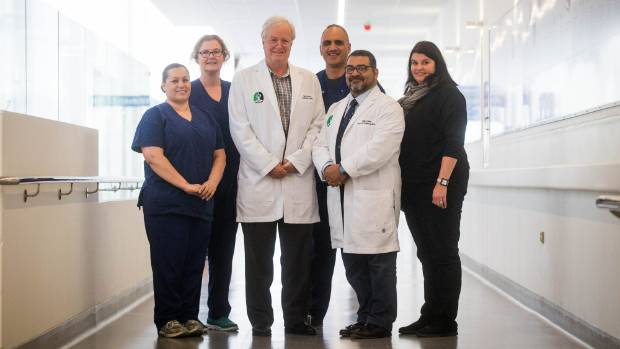 The Helping Hearts team Luisa Knight, Jackie Toy, Dr Grant Parkinson, Mark Tumai, Dr Adam El-Gamel and Tracy ...