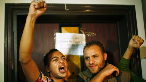 Palestinian youths react during a protest in front of the British consulate representative office in Gaza City, ahead of ...