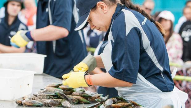 Guinness World Record holder Angela Fredericks competes in the Greenshell Mussel opening competition at the Havelock ...