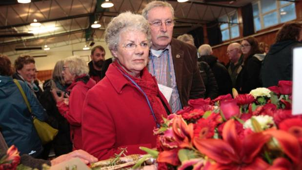 Wahine survivor Annetta Cowie looks at wreaths with husband Ross Cowie at Muritai School.