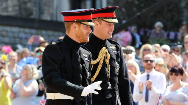 Prince Harry, left and his brother Prince William, the Duke of Cambridge arrive for the wedding ceremony.