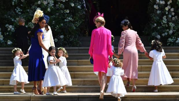 Kate, Duchess of Cambridge, third left, and Meghan Markle's friend, Canadian fashion stylist Jessica Mulroney, second ...