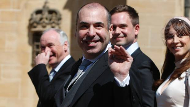 Actor Rick Hoffman from Suits waves as he arrives at St George's Chapel at Windsor Castle for the wedding.