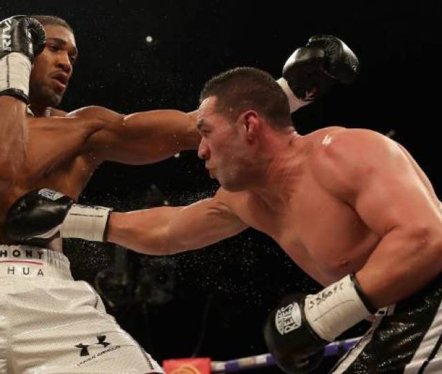 Joseph Parker Scores To The Body Of Anthony Joshua During Their World Title Unification Fight