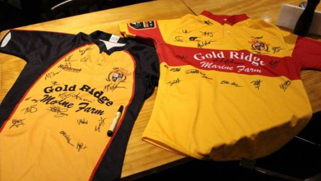 Team jerseys were being signed on the night.
