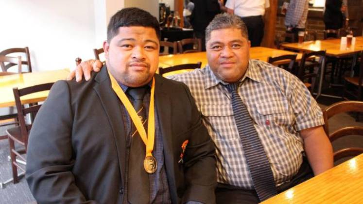 Sitiveni Tupou sits with his father Siosefo before the prizegiving begins.