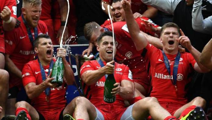 Sean Maitland (C, in front) leads the celebrations of the Saracens.
