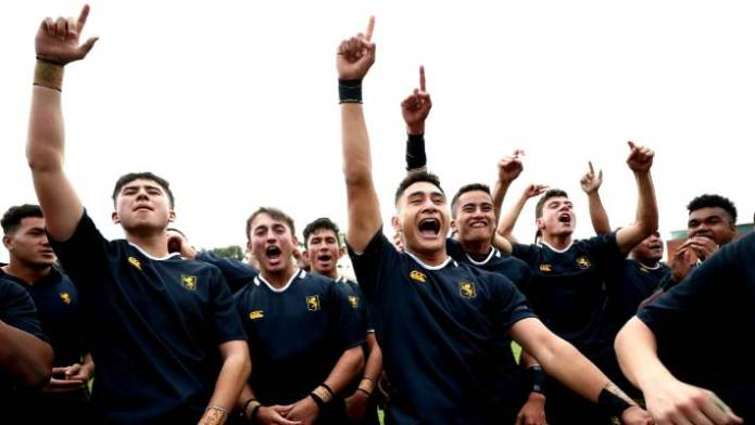 Auckland Grammar celebrates after their victory over the King's College on Saturday.