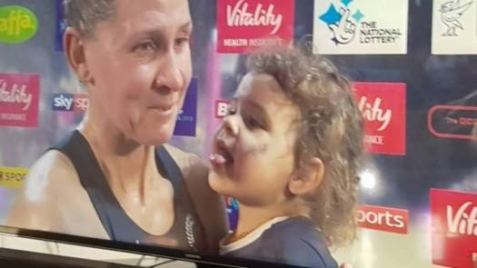 Casey Kopua's daughter Maia, about to lick sweat from her mum's neck and shoulder after the Silver Ferns' Netball World Cup win.