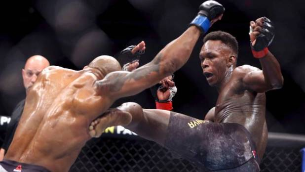 UFC middleweight champion Israel Adesanya on the attack against Yoel Romero.