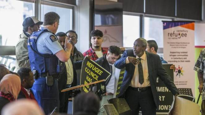 Mahmed Jama, right, was amongst the protesters who ambushed Saturday's World Refugee Day event.