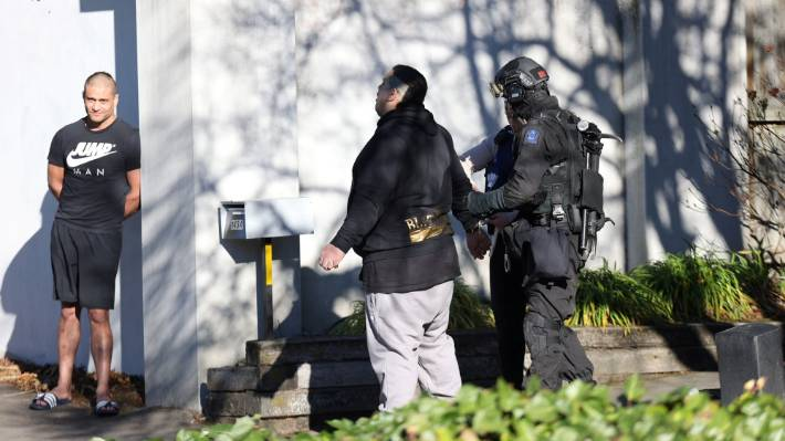 At least two people were in handcuffs at an address on Straven Rd in Fendalton on Thursday morning.